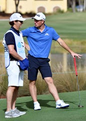 Viktor Hovland chats with his caddie on the 9th green during the QBE Shootout Pro-Am in Naples at the Tiburón Golf Club, Wednesday, Dec. 11, 2019.
