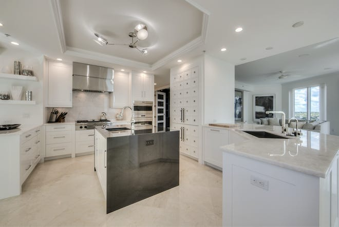 """An """"after"""" view of the newly renovated kitchen by Diamond Custom Homes in Aria at Park Shore."""