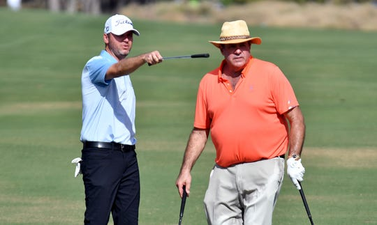 Sean O'Hair and Chris Berman talk about the green on the 6th hole during the QBE Shootout Pro-Am in Naples at the Tiburón Golf Club, Wednesday, Dec. 11, 2019.