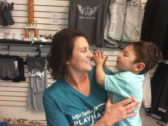 """Kai, who celebrated his second birthday on the day of the Dec. 11 ribbon cutting, is the inspiration for the new adaptive indoor gymnasium. Kai loves to sing and here shares a round of """"If You're Happy and You Know It (Clap Your Hands) with grandmother Mary Poole."""