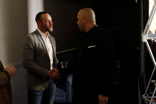 New York Mets manager Carlos Beltran, right, greets San Francisco Giants manager Gabe Kapler, former manager of the Philadelphia Phillies, between news conferences during the Major League Baseball winter meetings, Tuesday, Dec. 10, 2019, in San Diego.
