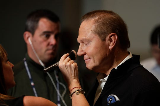 Sports agent Scott Boras closes his eyes as a woman applies make-up for a television interview at the Major League Baseball winter meetings Tuesday, Dec. 10, 2019, in San Diego.