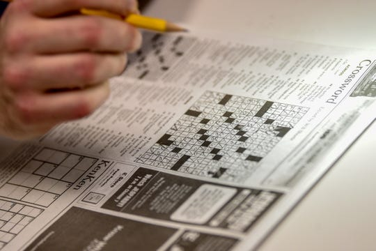 Howard Barkin, a regular finalist and the 2016 American Crossword Puzzle Tournament champion, does a crossword puzzle in  on Tuesday December 10, 2019.