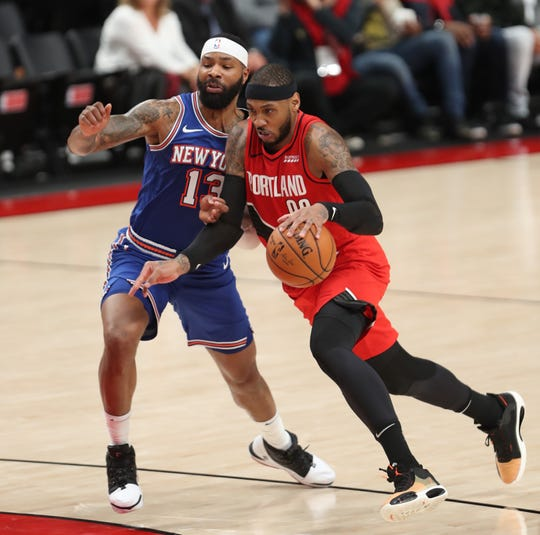 Dec 10, 2019; Portland, OR, USA; Portland Trail Blazers forward Carmelo Anthony (00) drives to the basket against New York Knicks forward Marcus Morris Sr. (13) in the second half at Moda Center. Mandatory Credit: Jaime Valdez-USA TODAY Sports