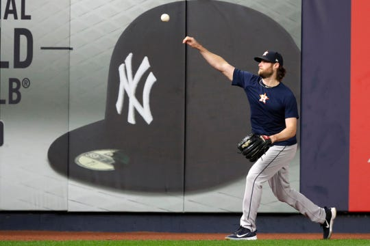 FILE - In this Monday, Oct. 14, 2019, file photo, Houston Astros Game 3 starting pitcher Gerrit Cole throws on the field at Yankee Stadium in New York, as the team prepared for the American League Championship Series against New York. Cole and the Yankees have agreed to a record $324 million, nine-year deal late Tuesday, Dec. 10, 2019.