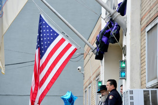 The flag is at half staff and bunting is at the entrance of the South District Jersey City Police Station the day after a shoot out with police in Jersey City, N.J. on Wednesday Dec. 11, 2019. One police officer, the two shooters and three civilians were killed.