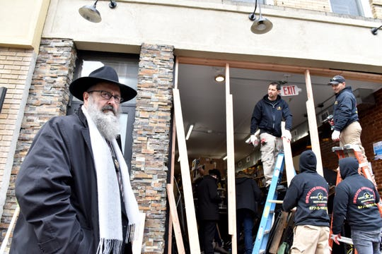 The facade of the street from the Jersey City Kosher Supermarket is rebuilt the morning after a shoot out with police in Jersey City, N.J. on Wednesday Dec. 11, 2019. One police officer, the two shooters and three civilians were killed.