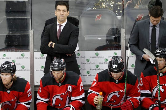 New Jersey Devils interim coach Alain Nasreddine, who replaced fired head coach John Hynes earlier in the day, watches during the third period of an NHL hockey game against the Vegas Golden Knights, Tuesday, Dec. 3, 2019, in Newark, N.J. The Golden Knights defeated the Devils 4-3 after Jonathan Marchessault had a third period hat trick.