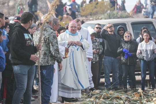 Bishop Peter Baldacchino blesses yucca to be made into walking sticks on the top of Tortugas Mountain as part of the Lady of Guadalupe festival in Las Cruces on Wednesday, Dec. 11, 2019.