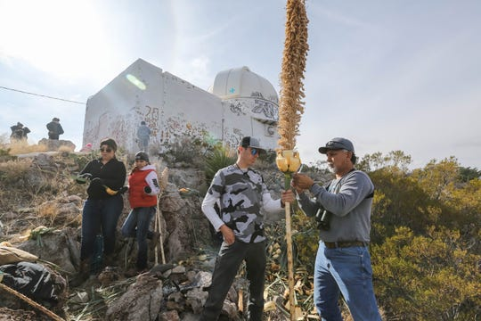 Pio Sanchez makes yucca walking sticks durring the pilgrimage to the top of Tortugas Mountain as part of the Lady of Guadalupe festival in Las Cruces on Wednesday, Dec. 11, 2019.