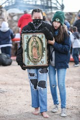 Lové Olmeda makes the pilgrimage to the top of Tortugas Mountain barefoot as part of the Lady of Guadalupe festival in Las Cruces on Wednesday, Dec. 11, 2019.
