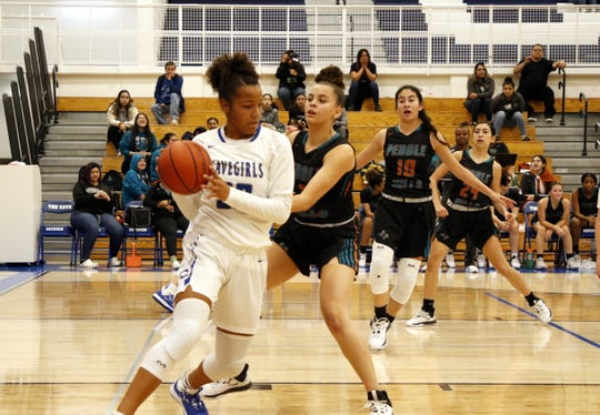 Carlsbad's Allie Myers looks for a teammate to pass to against Pebble Hills (TX) on Dec. 10, 2019. Myers finished with eight points and six rebounds. Carlsbad won in double overtime, 56-50.