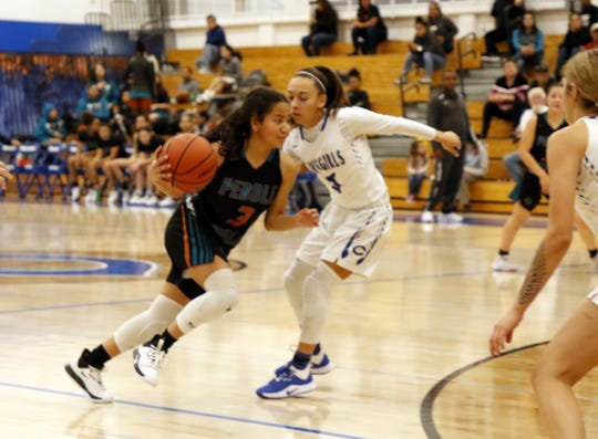 Pebble Hills' Laryssa Washington (3) drives the lane against Carlsbad's Baylee Molina (0) on Dec. 10, 2019. Carlsbad won in double overtime, 56-50.