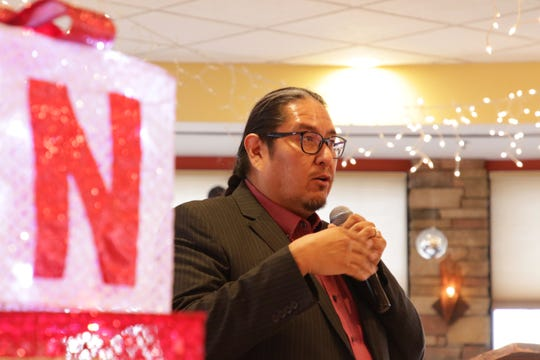 Navajo Transitional Energy Company's communication director, Erny Zah, announces grant recipients from NTEC's Community Benefit Fund at San Juan Country Club in Farmington on Dec. 11, 2019.