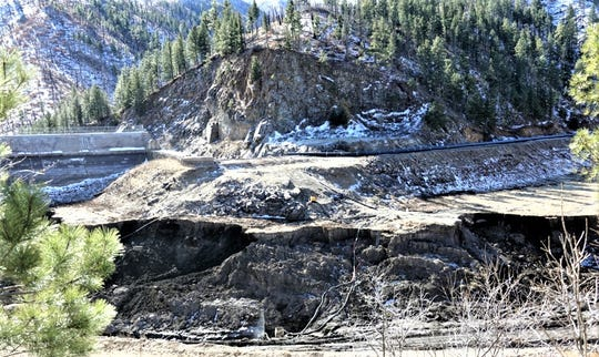 Looking directly at the spillway., excavators have removed nearly all of the earthen dam constructed earlier in the project on the left.  The photo also shows how much material still is left to  load and haul away.
