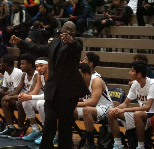 Wayne Memorial High's coach points to where he wants his team to set up an inbounds pass.