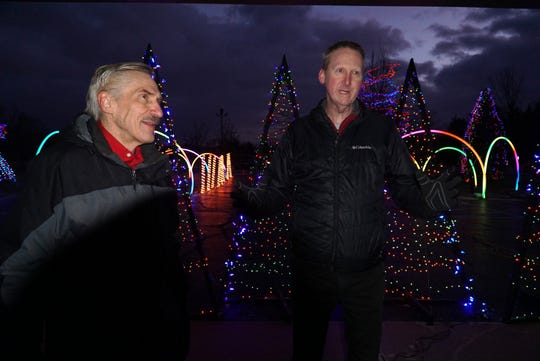 Ken Howse, left, with Livonia Lights, and Lead Pastor Brooks McElhenny of Northville Christian Assembly talk about the Northville Township's thrice-weekly Symphony of Lights Show at the Six Mile Road house of worship. The shows are performed Friday, Saturday and Sundays starting at 6 pm through Dec. 22nd. Howse used to run the light show in his Livonia neighborhood but managing the crowds are much easier at the large church grounds.