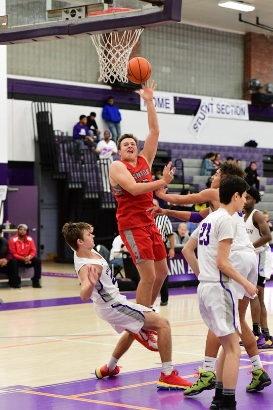 Canton's Jake Vickers puts up a shot against Pioneer.