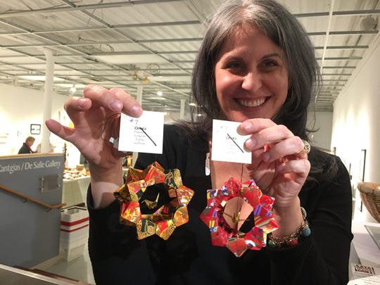 Rosemary Ashcraft found perfect wedding gifts for brides. These origami ornaments represent happiness, fidelity, peace and long life. A tiny origami crane is in the center of each ornament.