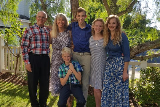 Bob Stedman, pictured with his wife, Teresa Stedman, and four of their five children, says his family was exempt from the federal tax penalty because of their membership in a health care sharing ministry. He plans to take the same exemption under the new California law.