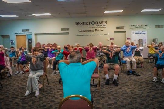 Seniors attend an Improve My Balance class led by Dr. Marc Eisman.