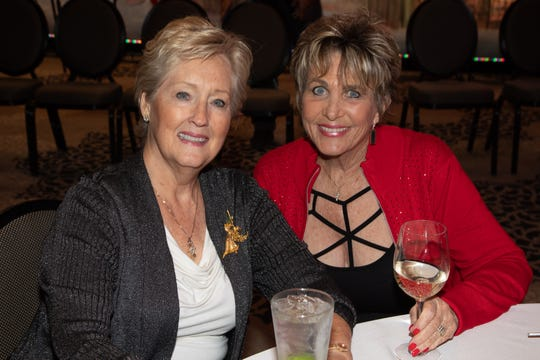 Board member and boutique chair Anne Pope enjoys a moment with Bonnie Ellena.
