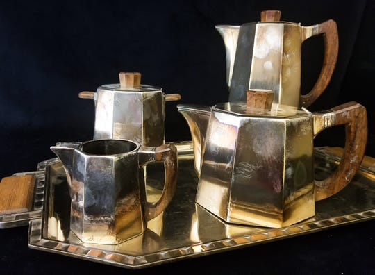 An otherwise beautiful sterling tea set sadly overcome with tarnish.