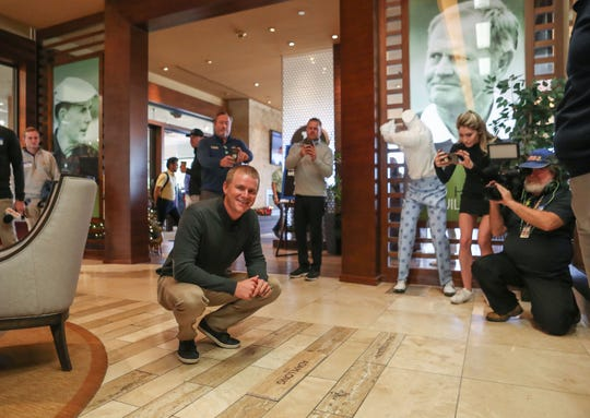 Defending champion Adam Long pauses for a photo after picking out the location for a tile with his name to be installed among those of other past champions of the American Express golf tournament in the clubhouse at PGA West in La Quinta, December 11, 2019.