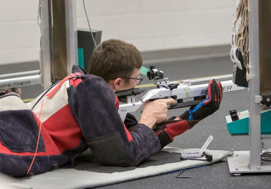 Senior and JROTC rifle team precision shooter Justin Casteel takes aim Tuesday during a competition at Enterprise High School in Enterprise, Alabama. Casteel said Joshua Kaleb Watson, who was killed in the Dec. 6 shooting at NAS Pensacola, gave him valuable shooting pointers while visiting his alma mater on leave from the U.S. Naval Academy.