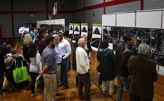Residents look at the latest pedestrian safety plans for West Cervantes at a public hearing at the Fricker Community Center on Tuesday, Dec. 10, 2019.