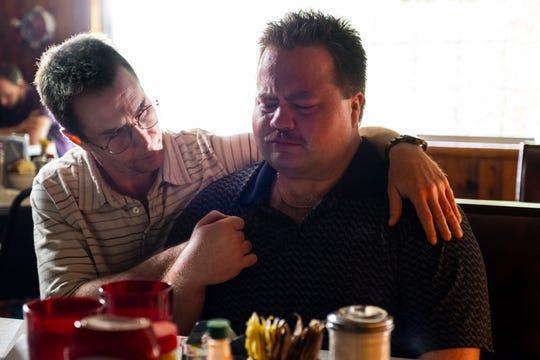 Sam Rockwell comforts Paul Walter Hauser in 'Richard Jewell.'
