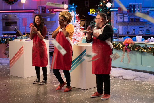 Lisa Chambers, center, won the grand prize on a holiday episode of Netflix baking show Nailed It!