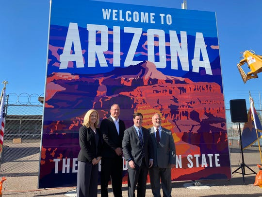 """Gov. Doug Ducey and other officials unveiled designs for new """"Welcome to Arizona"""" signs on Dec. 11, 2019."""