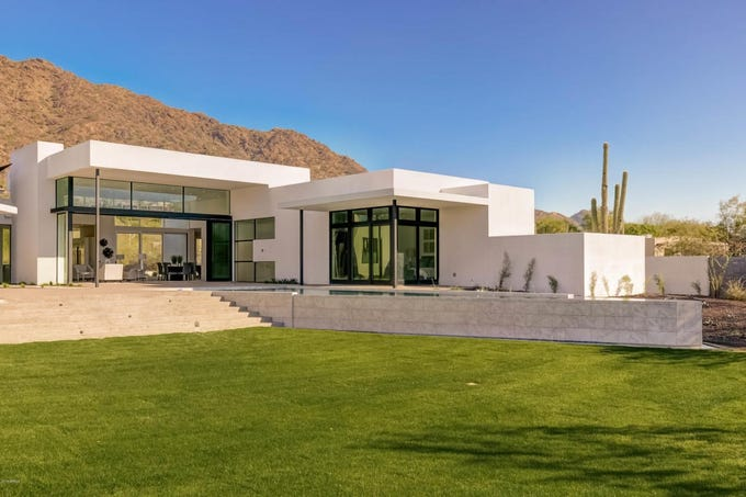 Peterson and his team relied on a mostly-white exterior for the home, but filtered in composite wood to add color.