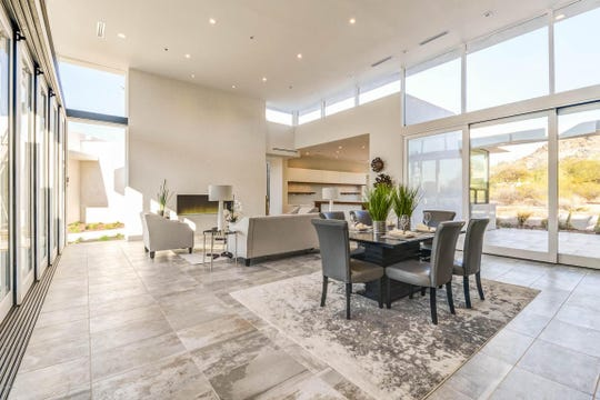 The home's family room is flooded with natural light thanks to an abundance of glass and windows.
