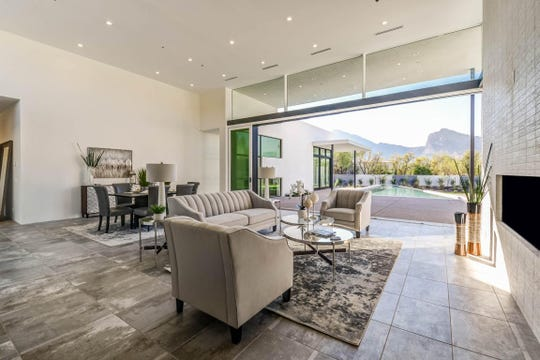 """From the home's entryway, the triangular pool is visible, pointing itself directly at the """"neck"""" of Camelback Mountain."""