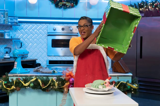 Avondale resident Lisa Chambers unveils her Green Eggs and Ham cake on Netflix's holiday season of Nailed It!