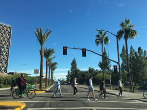 Students cross University Drive on the Tempe campus of Arizona State University