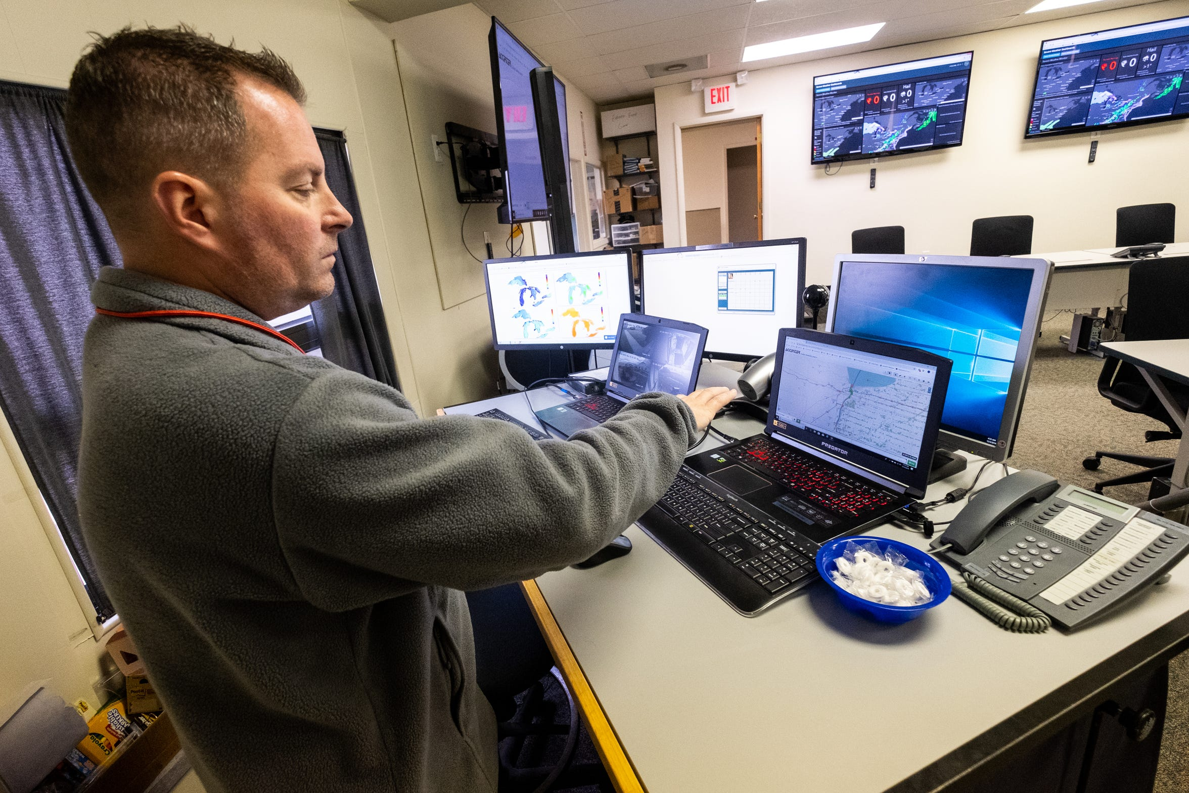 St. Clair County Emergency Management Director Justin Westmiller loads displays showing weather and general forecast data and other critical information in St. Clair County's Emergency Management Office Tuesday, Dec. 10, 2019, in Kimball Township.