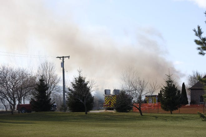 Heavy smoke can be seen coming from a barn fire in Wales Township Wednesday afternoon.