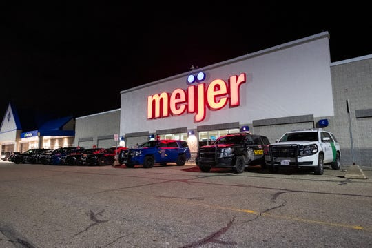 Different agency vehicles are lined up in front of the Fort Gratiot Meijer during the annual Christmas With A Cop Event Tuesday, Dec. 10, 2019. This year's event brought out over 100 kids.