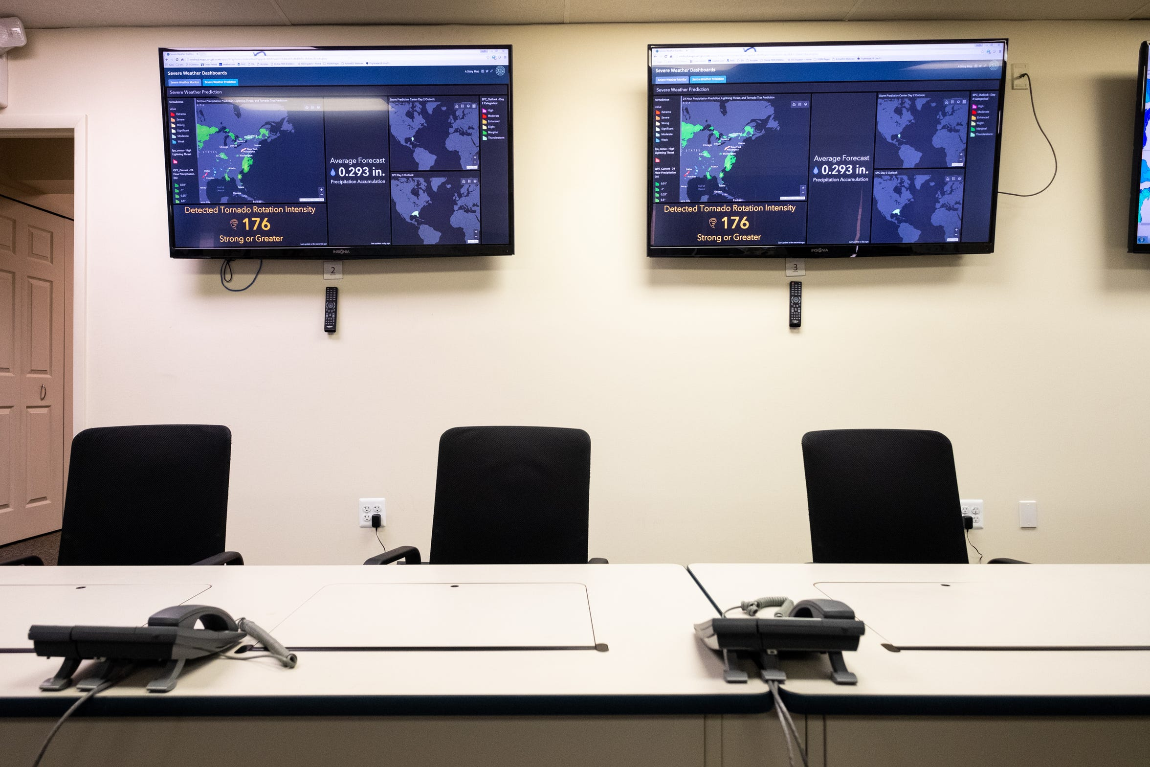 Screens tracking weather information hang on a wall in St. Clair County's Emergency Management Office in Kimball Township.