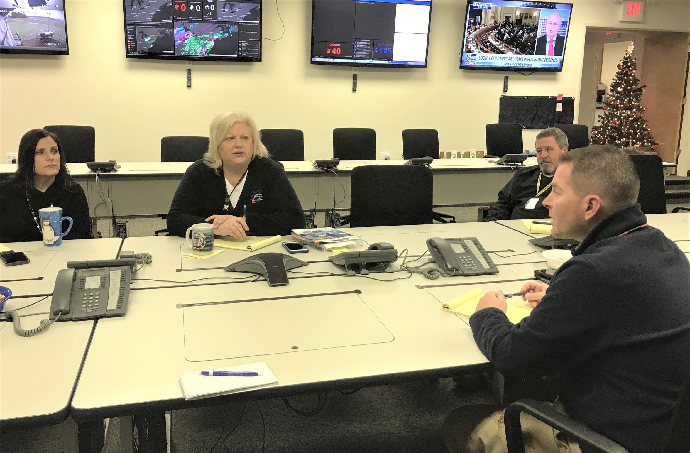 St. Clair County Emergency Management Director Justin Westmiller, right, meets with other officials at a staff meeting the morning of Monday, Dec. 9, 2018.