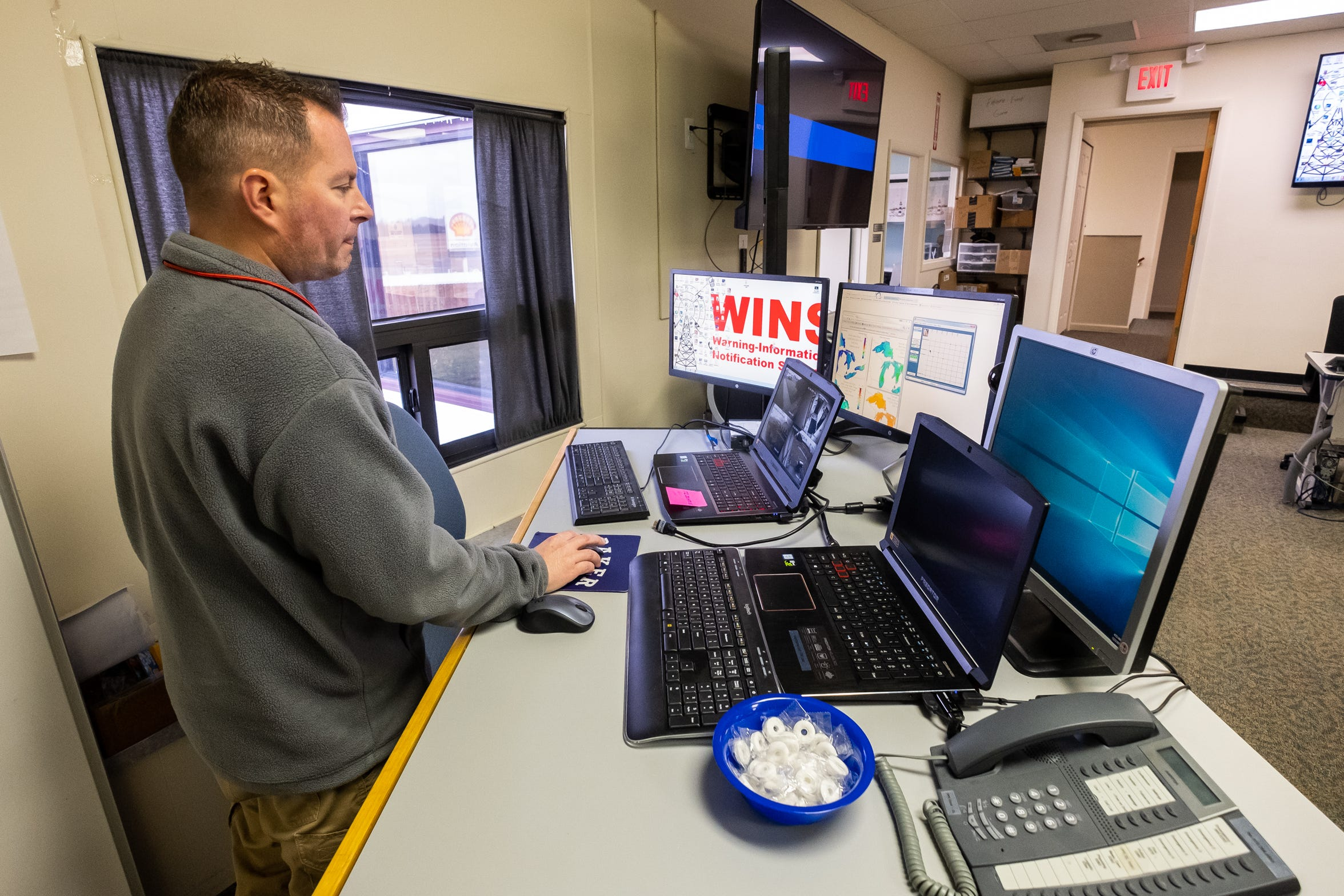 St. Clair County Emergency Management Director Justin Westmiller loads screens yay