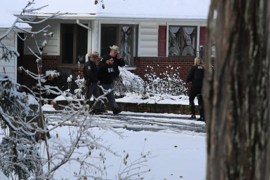 A man is apprehended by New York State Police from a house on Osborne Hill Road in the Town of Wappinger on Wednesday, Dec. 11, 2019.