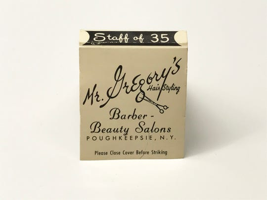 The front of a custom-made matchbook cover for Mr. Gregory's Hair Styling, from Mike Eidel's collection.