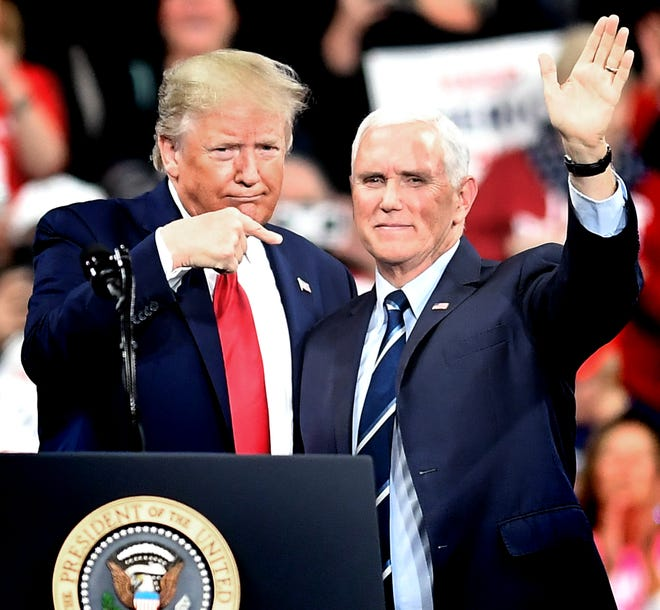 """President Donald Trump gestures toward Vice President Mike Pence as the two appeared together at a """"Keep America Great"""" rally at the Giant Center in Hershey Tuesday, Dec. 10, 2019. Bill Kalina photo"""