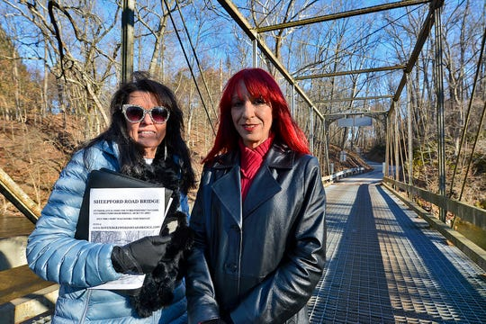 Lower Allen Township residents Joan Lenker, left, and Janice Lynx are working to save a bridge spanning the Yellow Breeches Creek that was built in the late 1800's.  Wednesday, December 11, 2019.John A. Pavoncello photo