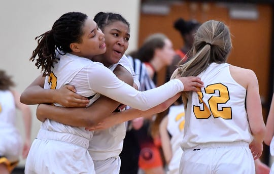 Asia Eames, left, Kamauri Goron-Bey, and Madi Shellenberger, of Red Lion celebrate after defeating Central York 42-41 in overtime, Tuesday, December 10, 2019.John A. Pavoncello photo