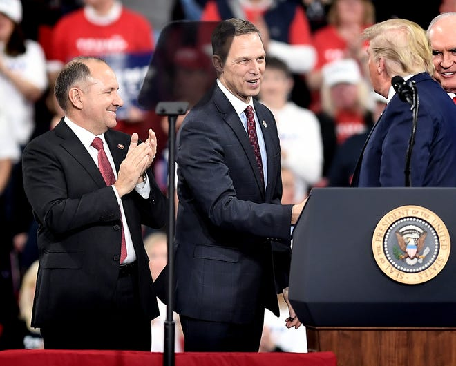 "U.S. Congressmen Lloyd Smucker, left, and Scott Perry take the stage with President Donald Trump, right, at a ""Keep America Great"" rally at the Giant Center in Hershey Tuesday, Dec. 10, 2019. Bill Kalina photo"